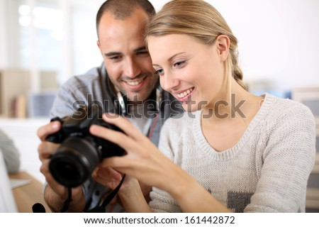 Students in photography working together on project - stock photo