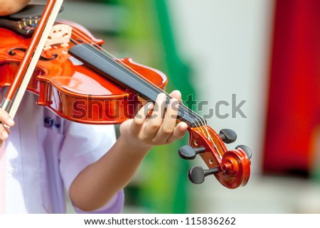 Students learn to play the violin. - stock photo