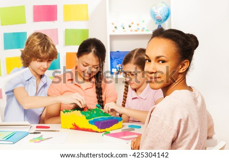 Students learning geography at the classroom - stock photo
