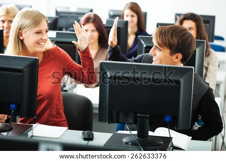 Students learning in computer lab - stock photo