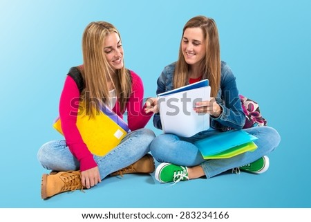 Students learning over colorful background - stock photo