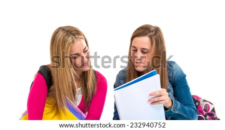 Students learning over isolated white background - stock photo