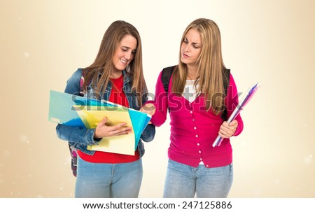 Students learning over ocher background - stock photo