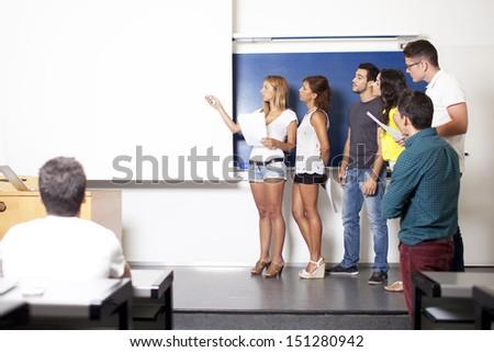 students making a presentation - stock photo