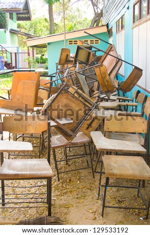 Students not on the table were a pile waiting to be restored back again. - stock photo