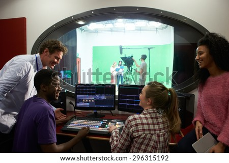 Students On Media Studies Course In TV Editing Suite - stock photo