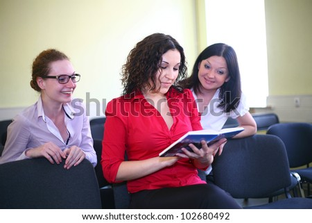 Students read a book together - stock photo