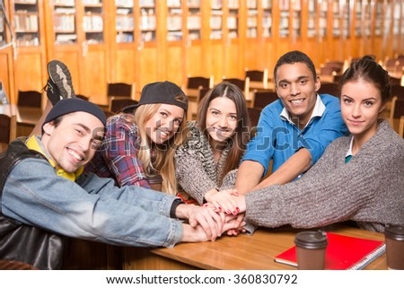 Students showing teamwork - stock photo