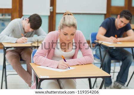 Students sitting an exam in exam hallin college