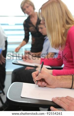 Students sitting at desks - stock photo