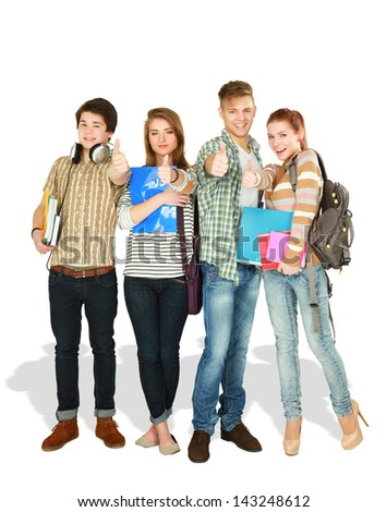 students standing together and showing thumbs-up - stock photo