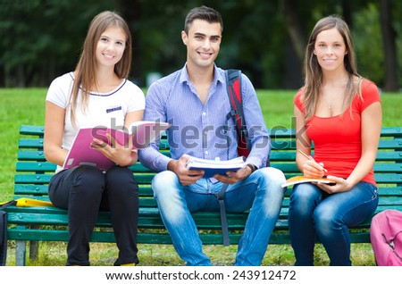 Students studying at the park - stock photo