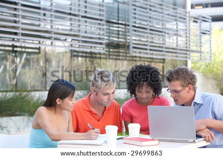 Students studying outside - stock photo