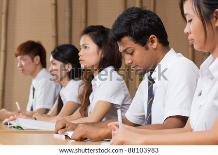 students studying together in a classroom.