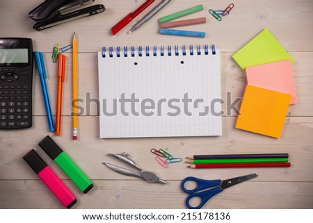Students table with school supplies on it - stock photo