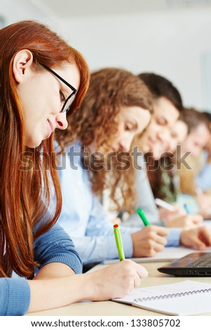 Students taking a test in class in a school - stock photo