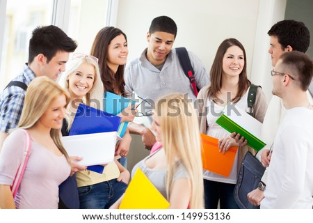 Students talking in the hallway. - stock photo