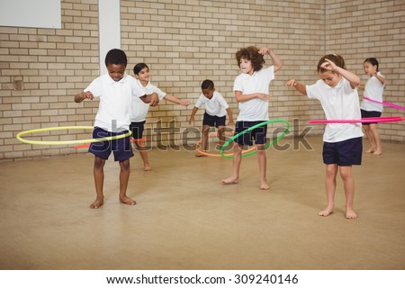 Students using some hula hoops at the elementary school - stock photo