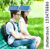 Students with a book on his head in the park - stock photo