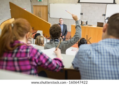 Students with a teacher at the college lecture hall - stock photo