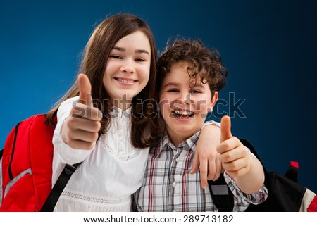 Students with backpack showing OK sign - stock photo