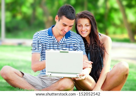 Students with laptop at outdoor - stock photo