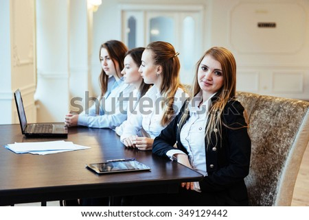 Students with laptops and tablet - stock photo