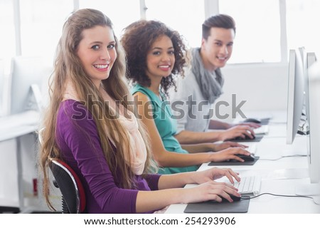 Students working in computer room at the college