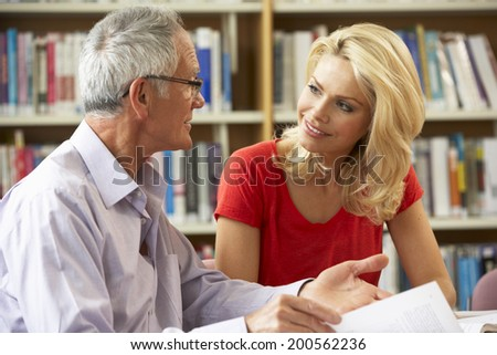 Students working in library - stock photo