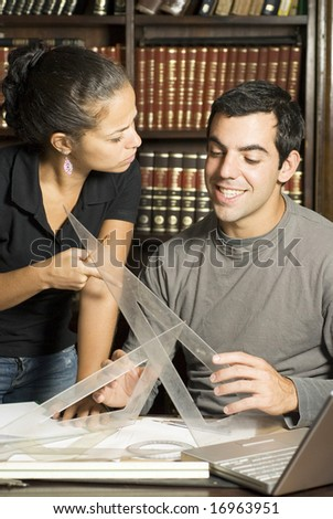 Students Working on paperwork with compasses. Vertically framed photo. - stock photo