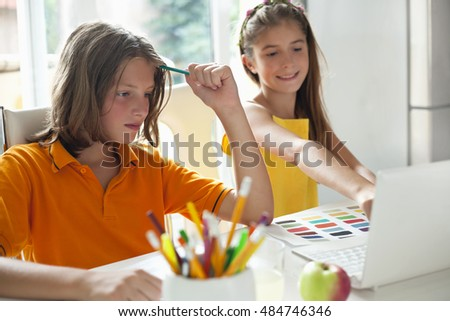Students write a test in the classroom