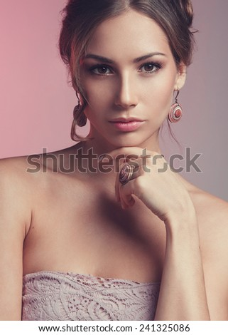 Studio beauty portrait of young woman with jewels