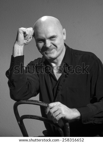 Studio black and white portrait caucasian bald men. Emotions. suppressed laughter - stock photo