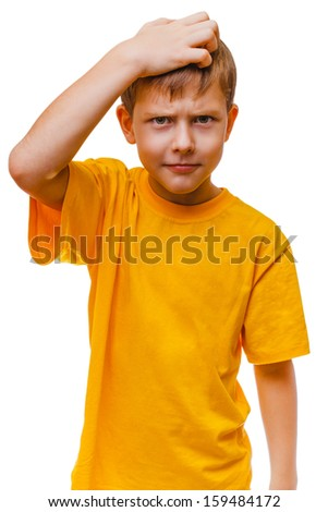 studio blond boy in yellow shirt is thinking scratching his head hair, confused isolated on white background - stock photo