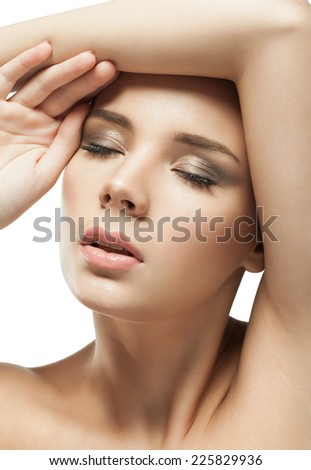 Studio close up portrait of a young European woman with clear healthy perfect skin on a white background isolated. Beauty model woman face - stock photo