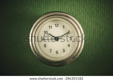 Studio conceptual composition presenting old used simple watch.