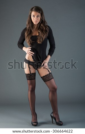 Studio dress and pantyhose glam - stock photo
