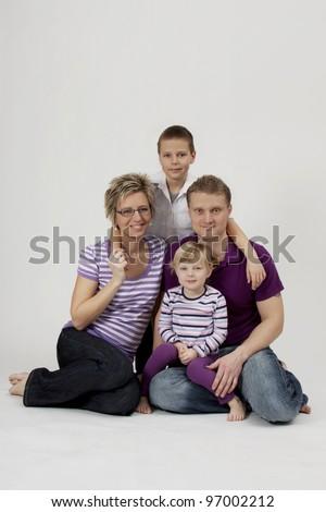 Studio family portrait - stock photo