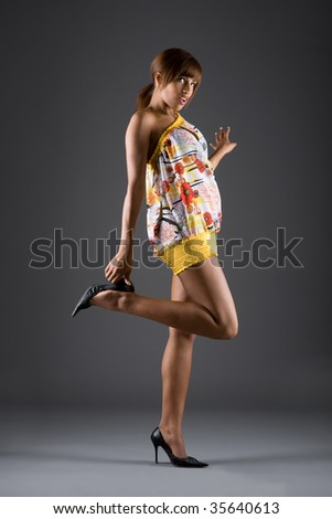 Studio fashion picture from a young brunette model - stock photo