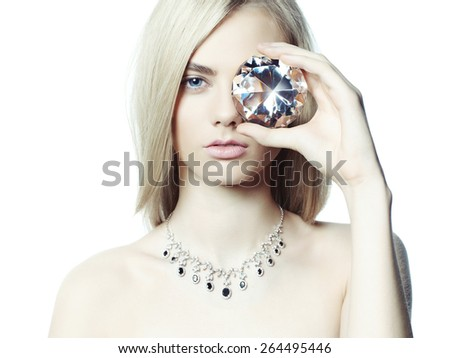 Studio fashion portrait of young beautiful lady in jewelry - stock photo