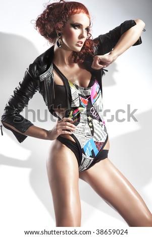 Studio fashion shot of a beautiful lady - stock photo