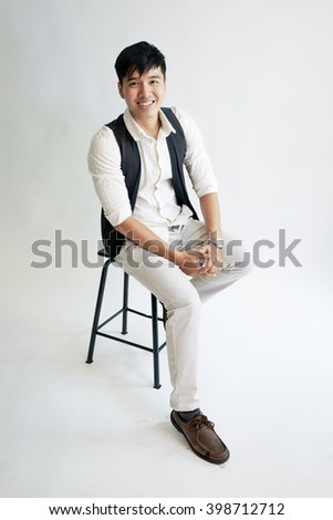 Studio fashion shot of young men model on white background - stock photo