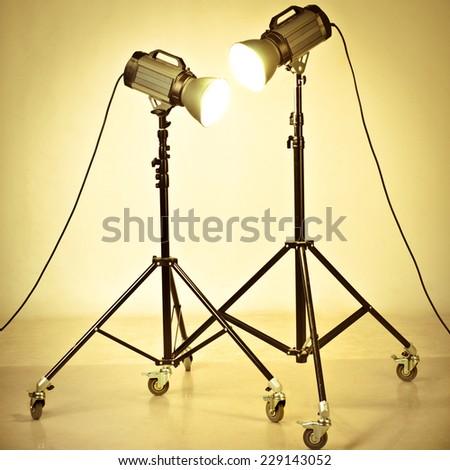 studio flash on a tripod - stock photo