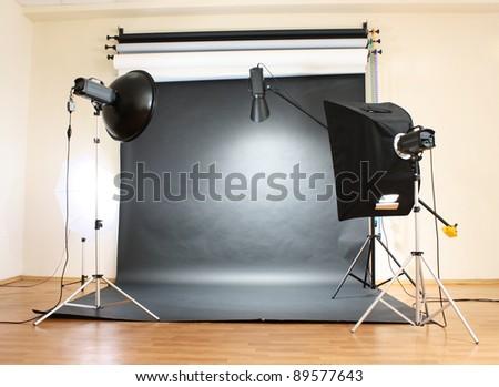 Studio flash on grey background - stock photo