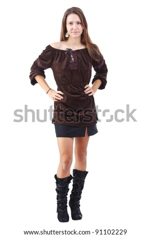 Studio full length body shot of beautiful fashionable brunette woman