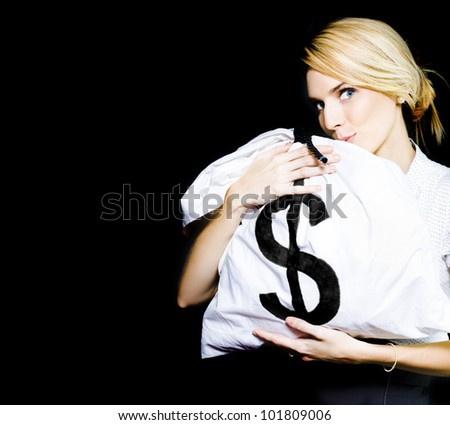 Studio Image Of A Business Woman Kissing A Money Bag Full Of Monetary Gains And Earning In A Winning Business And Financial Success Concept On Black Background - stock photo