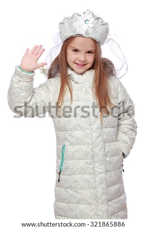Studio image of a charming cheerful little girl in a role of Russian Snow Maiden in the headdress on Holiday - stock photo