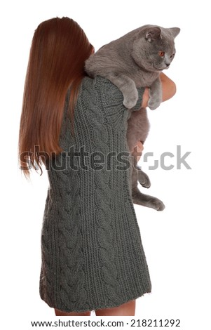 Studio image of a cheerful little girl played with a British breed of cat isolated on white/little girl holding british cat - stock photo