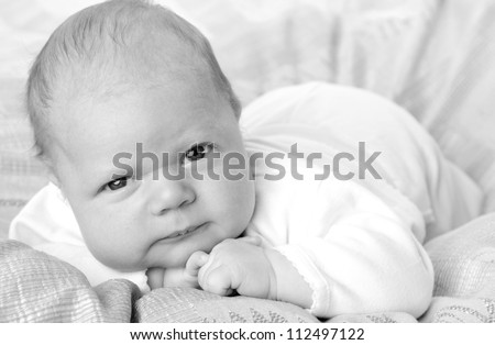 Studio image of black and white portrait of lovely kid