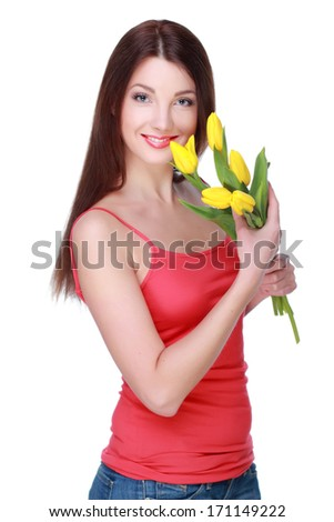 Studio image of gorgeous young woman with yellow tulips/Beautiful girl holding a bouquet of fresh flowers on Holiday - stock photo
